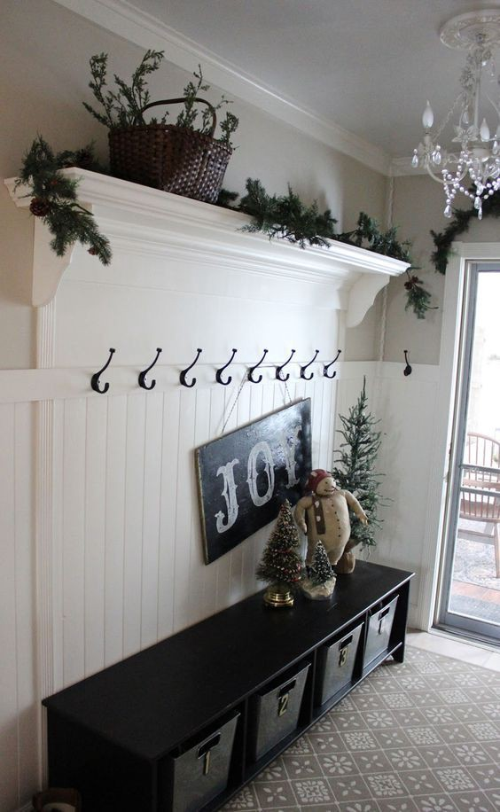 This is a simple foyer mudroom idea - love the special touches for Holiday / Christmas decorations.  Not sure this is enough to REALLY declutter all the stuff, but it's beautiful