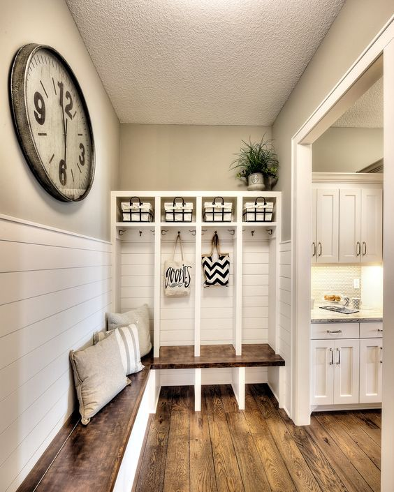 This DIY mudroom idea could be PERFECT for our house.  The separate section/cubbies are perfect for the kids to put their stuff so the house appears clutter-free and organized.  LOVE that big wall clock too and the pallet bench.