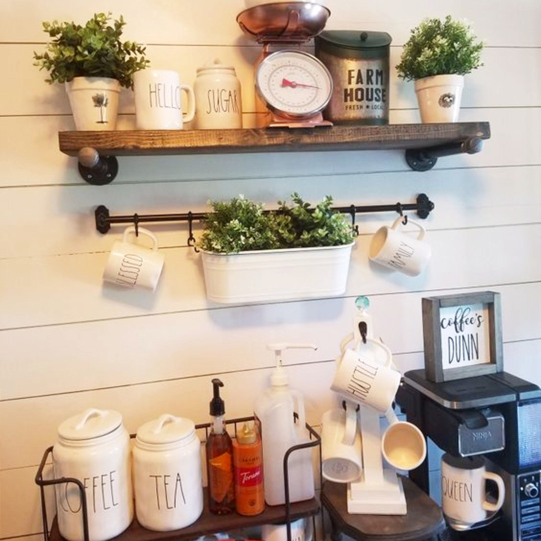 Gorgeous farmhouse coffee bar idea!  Shiplap wall, industrial pipe shelves and oh yes, the Rae Dunn coffee canisters and coffee mugs.  Beautiful!