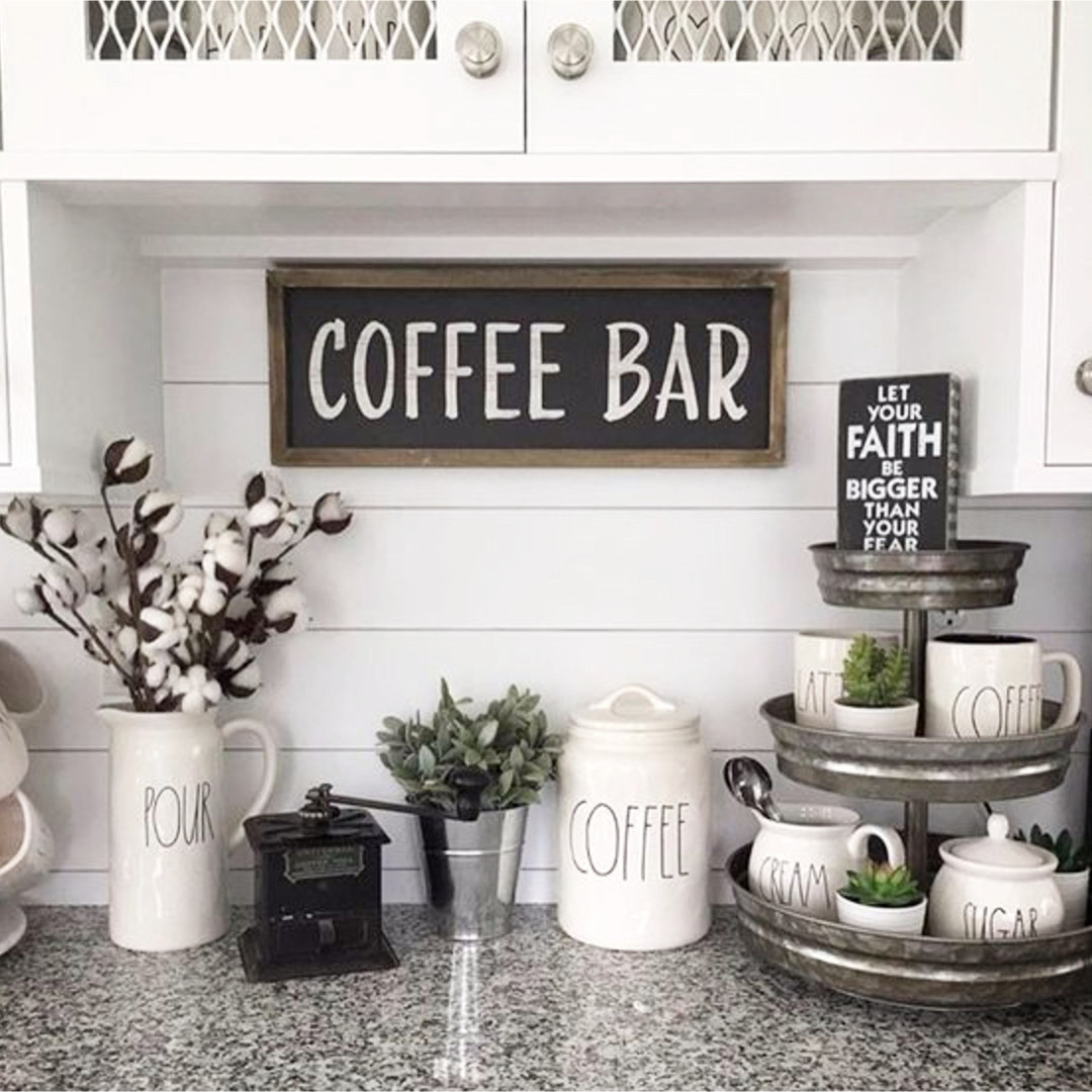 Beautiful coffee bar set up ideas on this kitchen counter.  Love the Rae Dunn coffee mugs and canisters and that 3-tier organizer is a great touch
