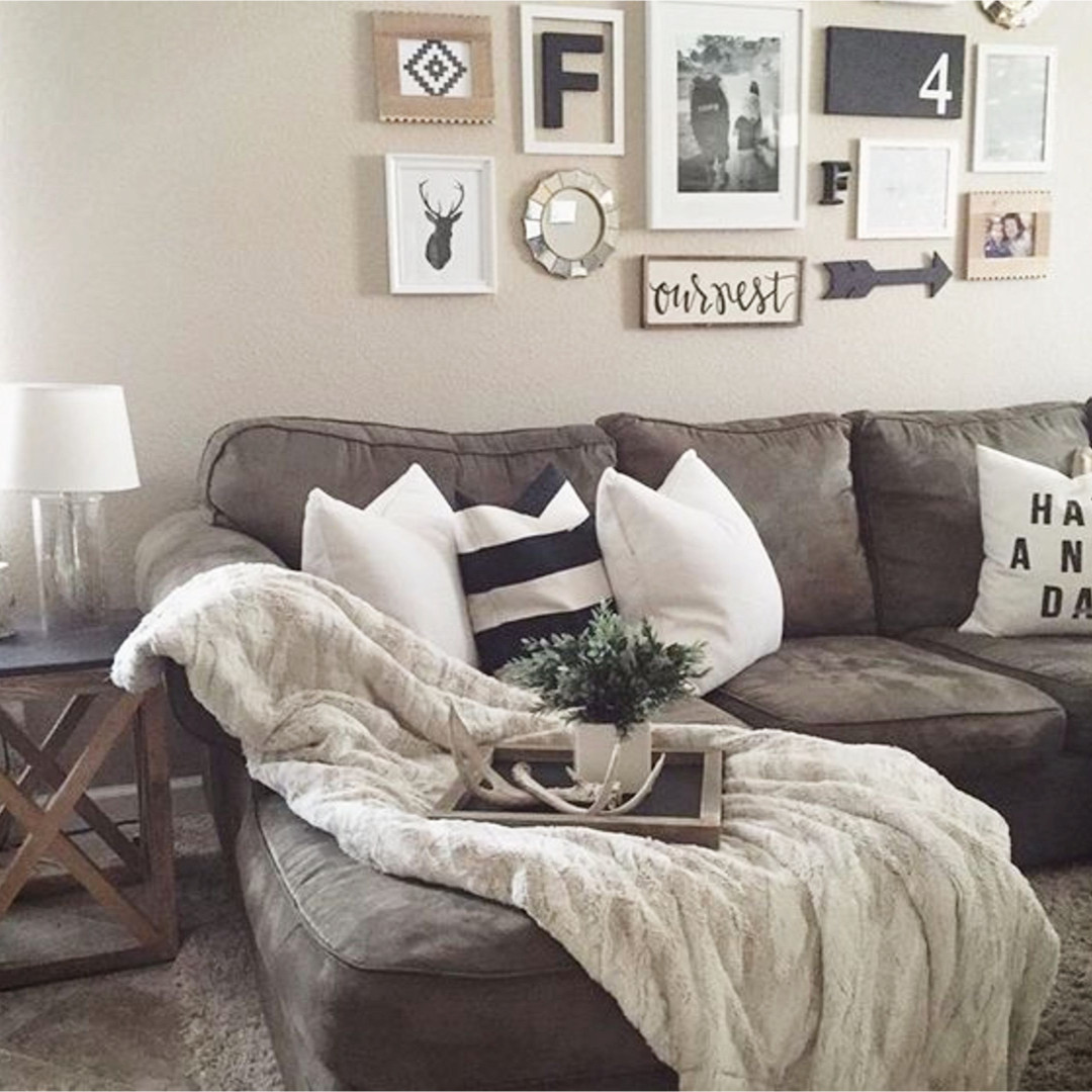 Beautiful neutral living room with rustic farmhouse decor - and LOVE that accent wall over the couch.  Nice DIY gallery wall design! #gallerywallideas #decoratingideas #livingroomideas #diyhomedecor #homedecorideas