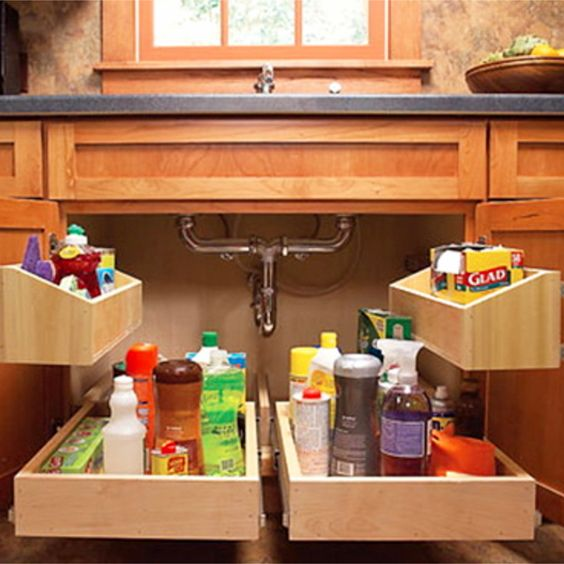 Smart way to declutter and organize under your kitchen sink - and wow, how easy it would be to find everything! #gettingorganized #organizationideasforthehome #getorganized #cleaninghacks #kitchenideas #kitchenorganization #cleaningtricks #organizedhome #diyideas #diyinspiration #organizingtips