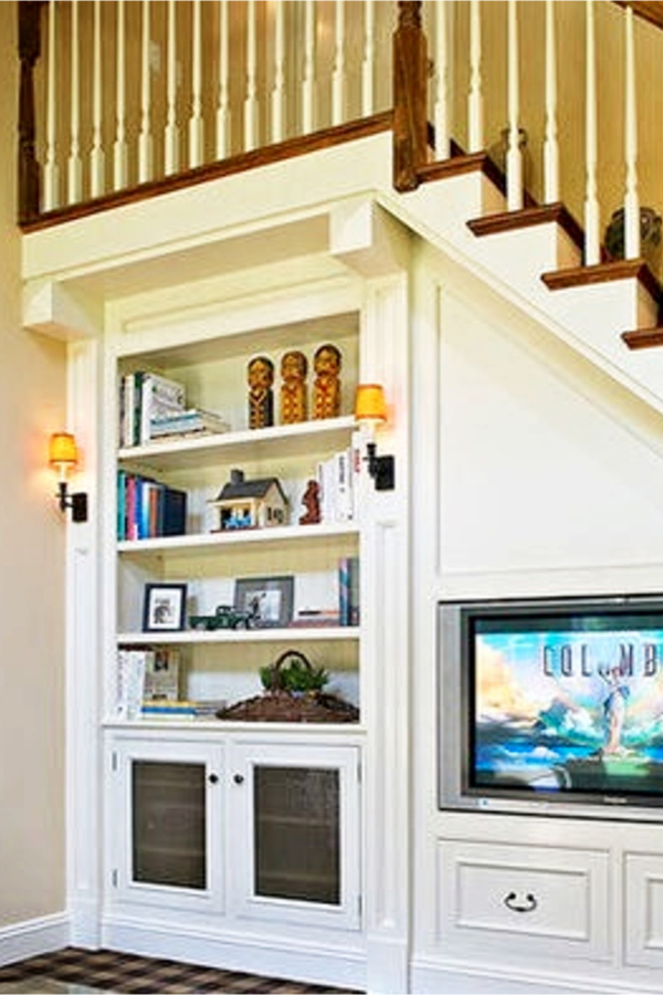 Under stair storage ideas - bookshelves and entertainments center under stairs