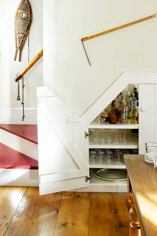 Under stair storage ideas - small storage cubby under stairs for wine glasses and other kitchen storage needs