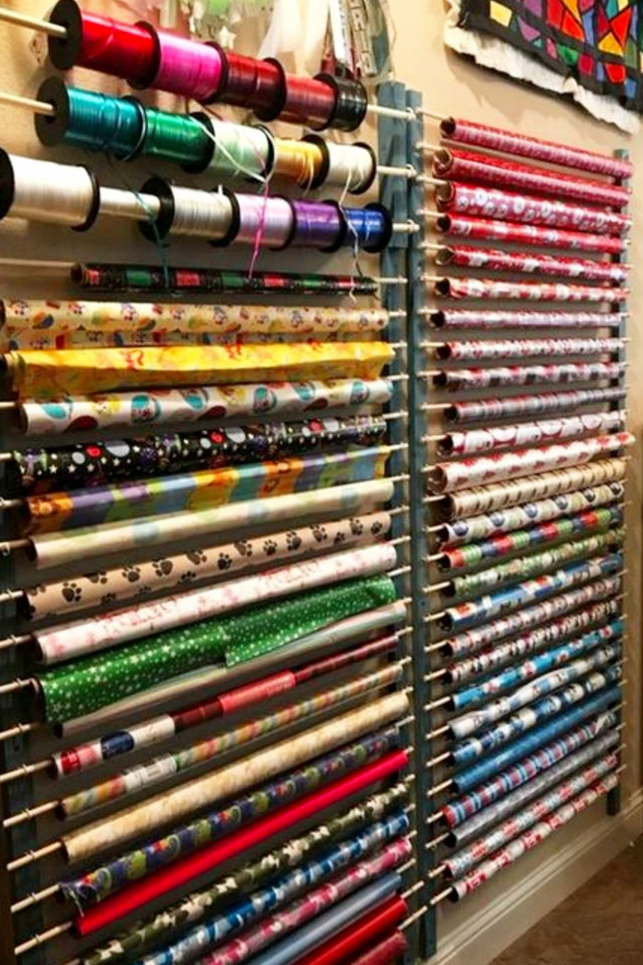 Craft room organization on a budget - cheap ideas for organizing your craft room, sewing room or wrapping room - organizing wrapping supplies on a craft room wall